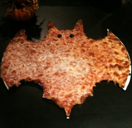 Father and Son Halloween bat pizza
