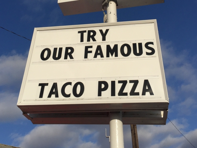 Try Our Famous Taco Pizza - Sign at Mickey & Bill's, 3102 Foltz, Mars Hill
