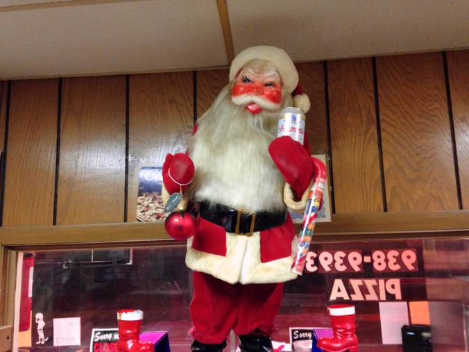 Santa Christmas Display with Hamm's Beer in Front of Wood-Paneling and Window Onto Lake Street at Ono's - December 2014