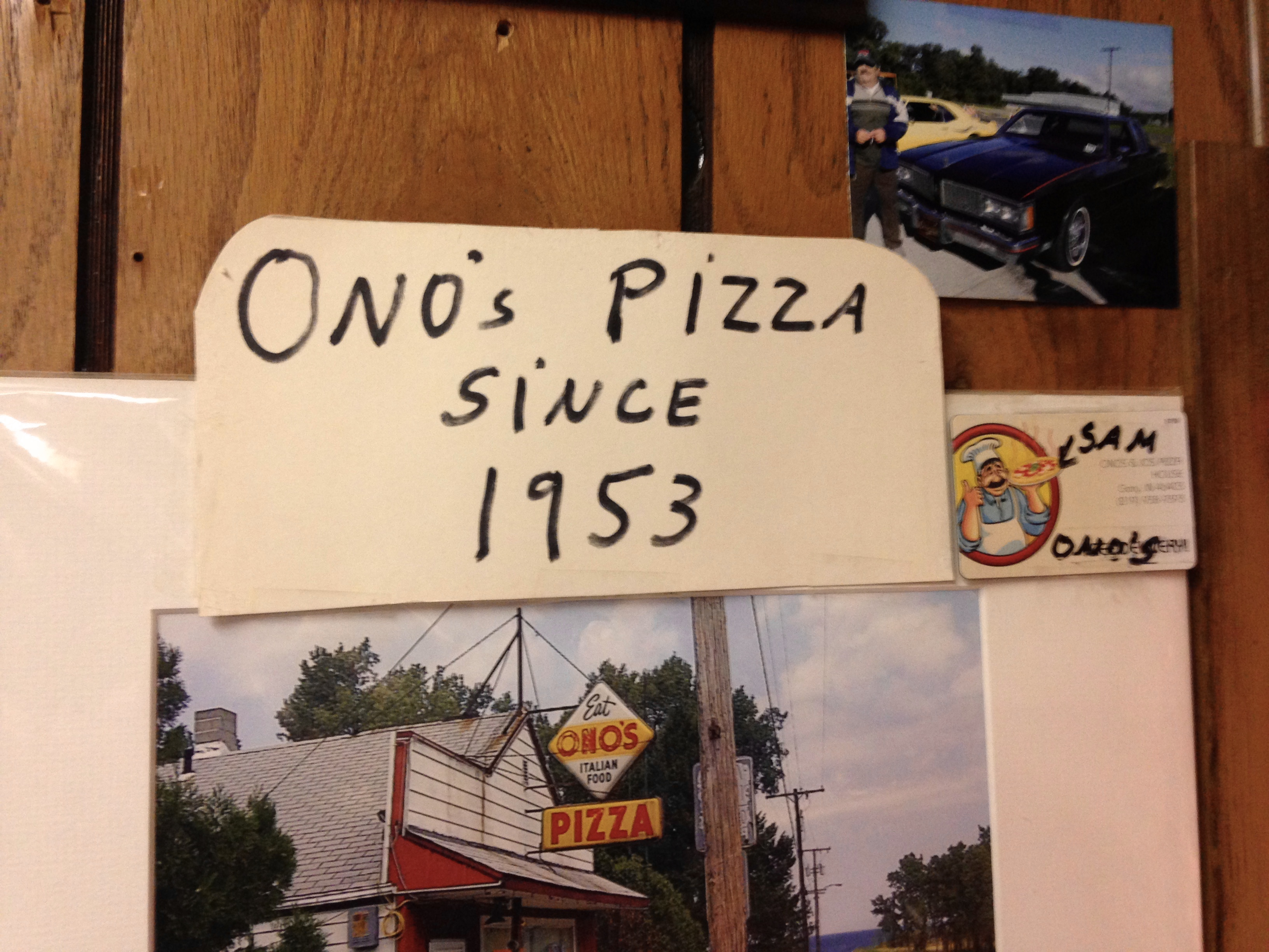 "Handwritten Sign Stating ""Ono's Pizza Since 1953,"" with Business Card and Photo of Sam and His Car"